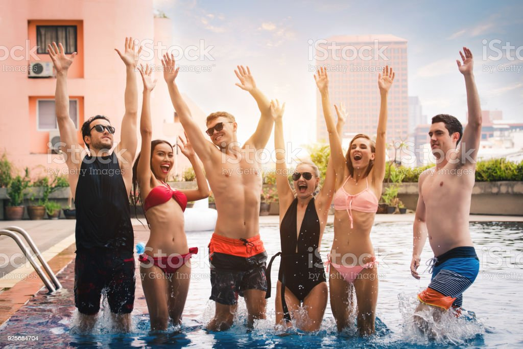 Group of Friends in Swimsuit and Bikini Enjoy Pool Party on Holiday...