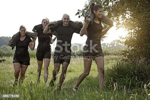 istock group of friends jogging with the weights outdoors 486278436