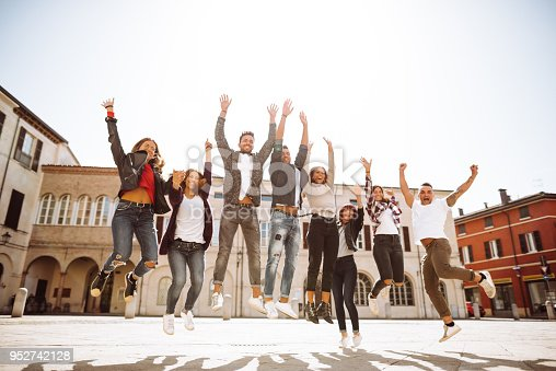 istock group of friends jumping all together on the city 952742128