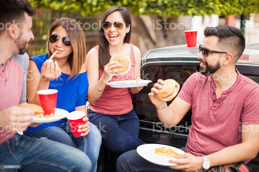 Group of friends laughing at a barbecue stock photo