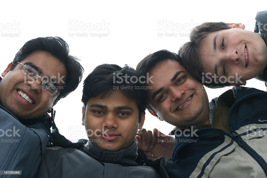 Group of Friends Looking Down at Camera with White Sky royalty-free stock photo