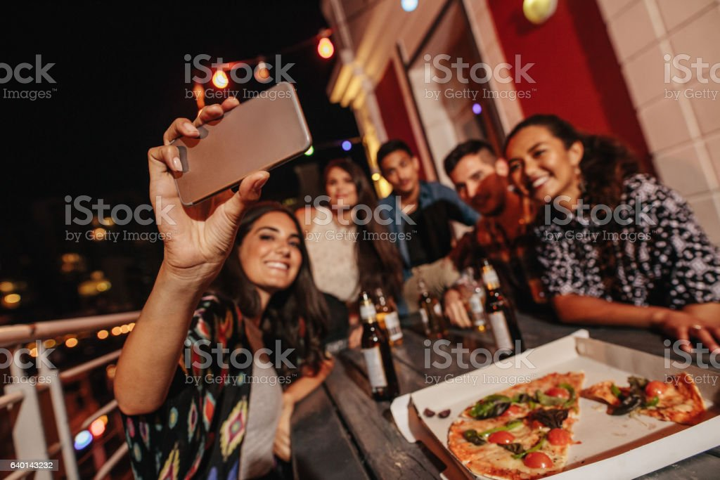 Group of friends making a selfie at rooftop party stock photo