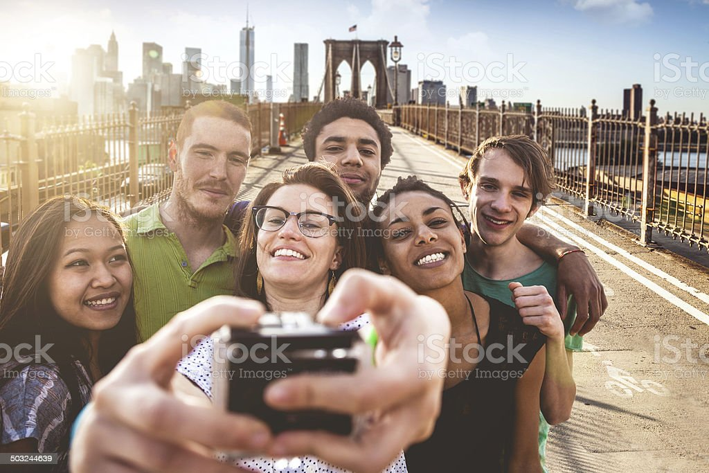 Group of friends making an usie on Brooklyn Bridge stock photo