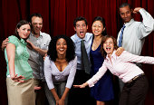 istock Group of friends making humorous expressions by curtain, portrait 74362411