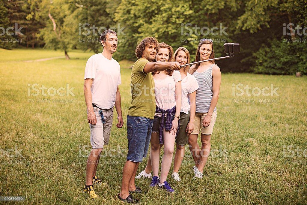 Group of friends making selfie in nature zbiór zdjęć royalty-free