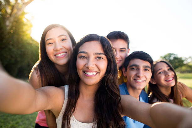 Group of friends making selfie stock photo