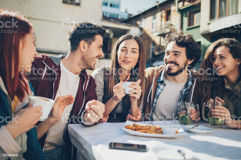 Group of friends meet for a brunch and coffee stock photo