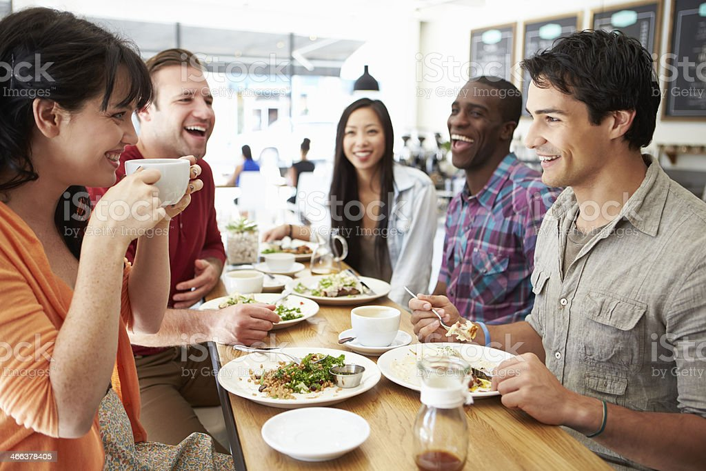Group Of Friends Meeting For Lunch In Coffee Shop stock photo
