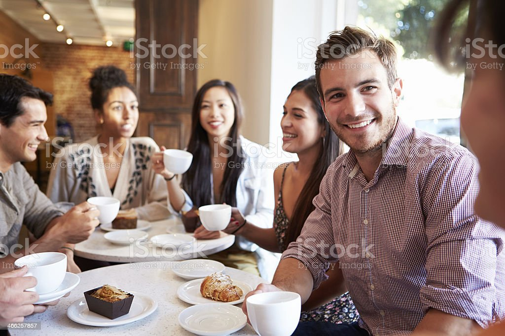 Group Of Friends Meeting In Café Restaurant stock photo