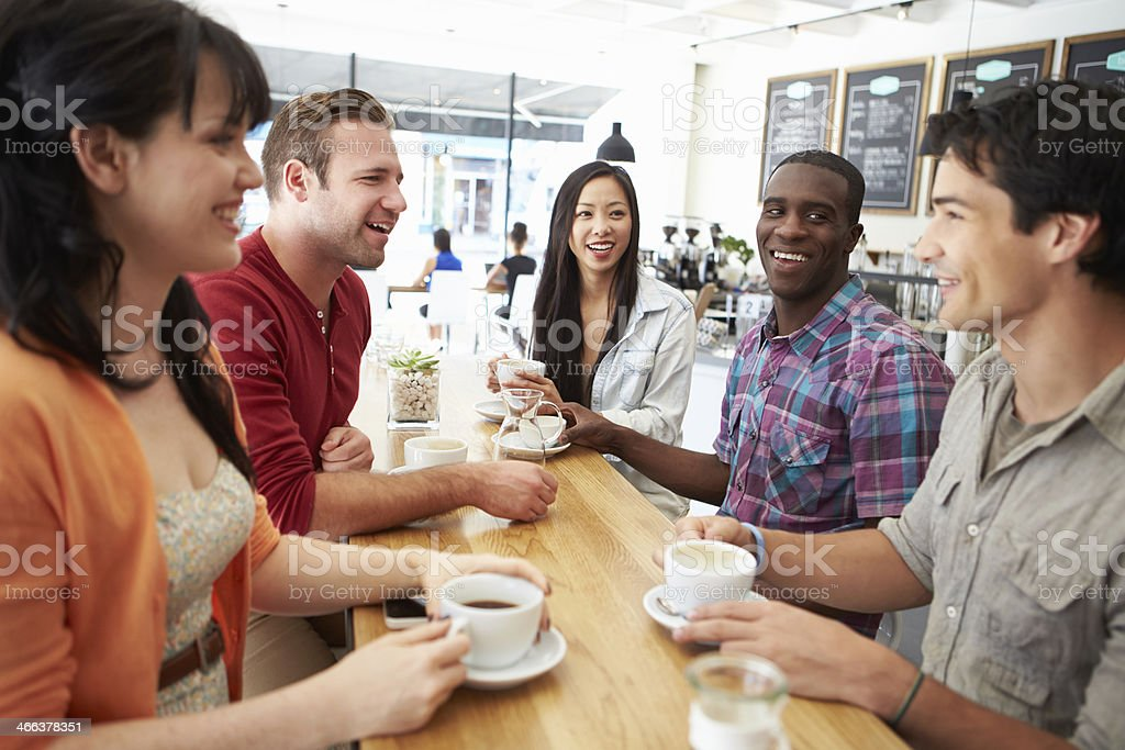 Group Of Friends Meeting In Coffee Shop stock photo
