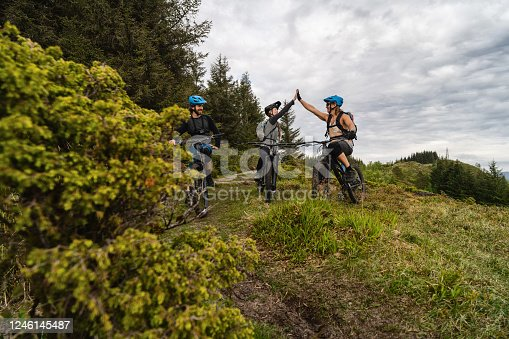 Group of friends mountainbike MTB riders: biking outdoor up mountain of Norway