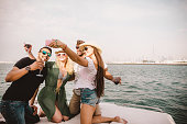 Group of friends having fun on yacht in Dubai.