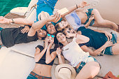 Group of Friends on a Yacht taking Selfie on a Yacht. Social weekend fun together.