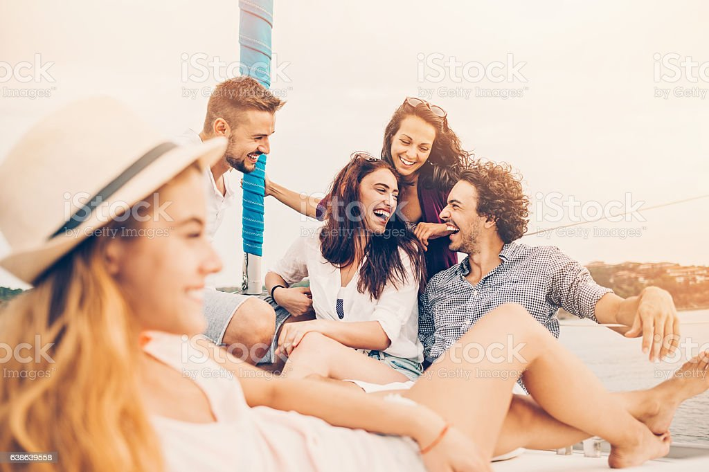 Group of friends on a yacht stock photo