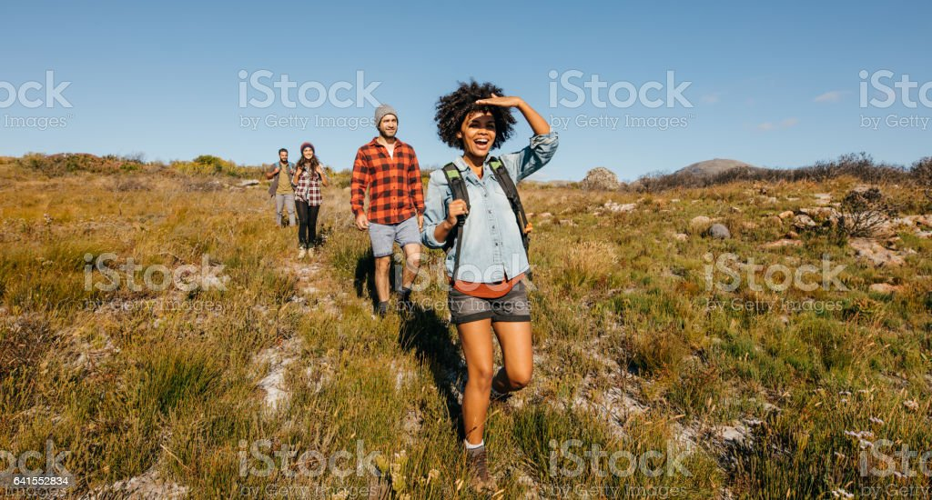 Group of friends on country walk stock photo