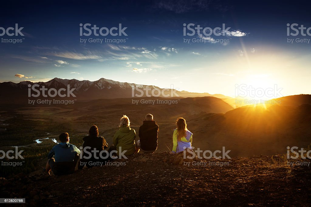 Group of friends on mountains background stock photo