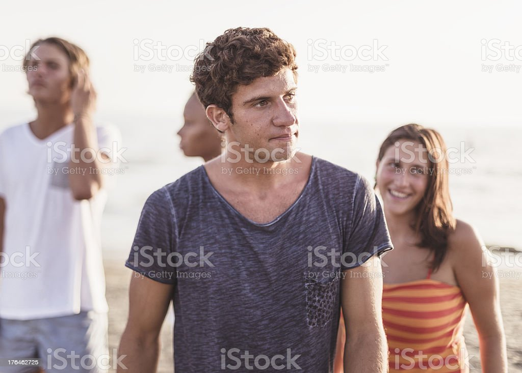 group of friends on the beach royalty-free stock photo