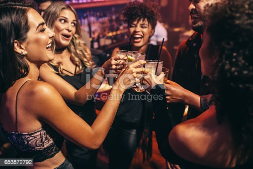 istock Group of friends partying in a nightclub 653872792