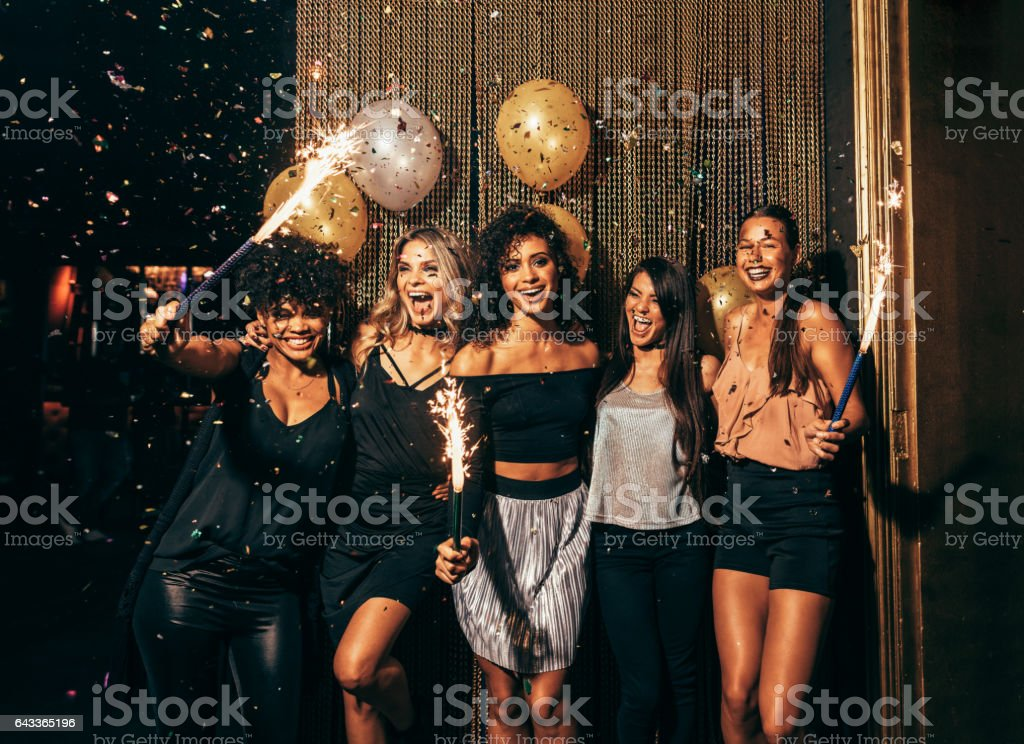 Group of friends partying in nightclub royalty-free stock photo