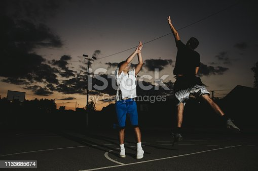 istock Group of friends playing basketball 1133685674