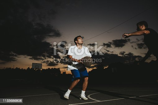 istock Group of friends playing basketball 1133686806