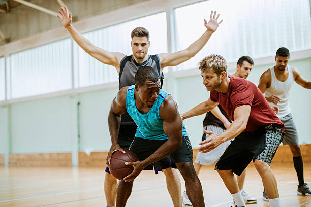 group of friends playing basketball - game of life stock photos and pictures