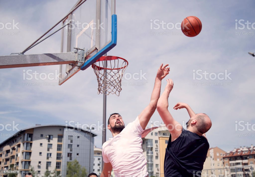 Group of friends playing basketball royalty-free stock photo