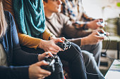 istock Group of friends playing digital games at home. 898628762