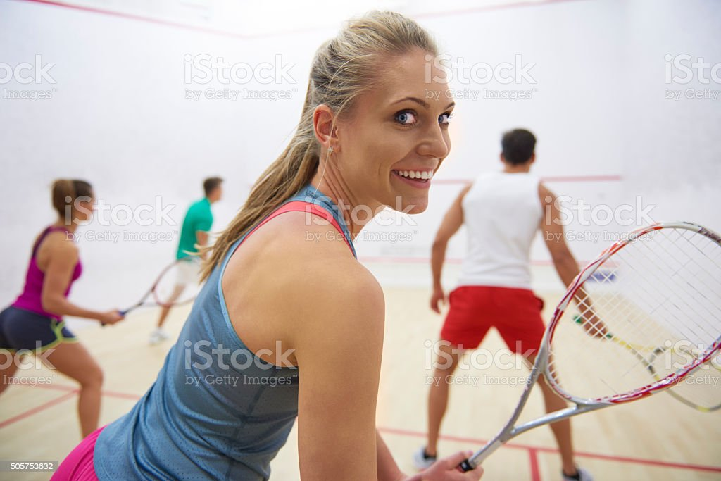Group of friends playing in squash stock photo