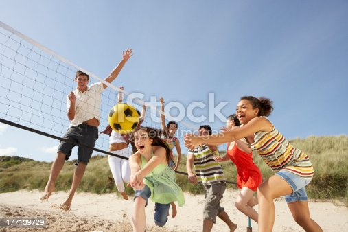 istock Group of friends playing volleyball on the beach 177139729