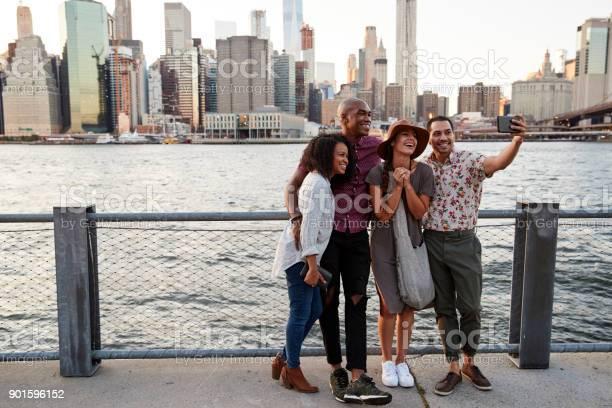 Group of friends posing for selfie in front of manhattan skyline picture id901596152?b=1&k=6&m=901596152&s=612x612&h=ueyau2rktt p5ibsjjrcqwya2zsu4hxje s0zoockag=