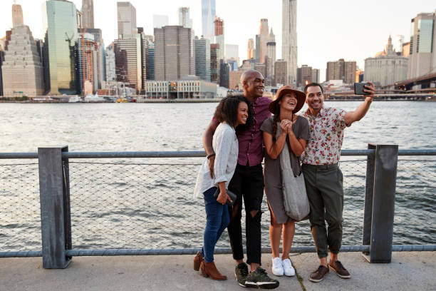 group of friends posing for selfie in front of manhattan skyline - tourism stock pictures, royalty-free photos & images