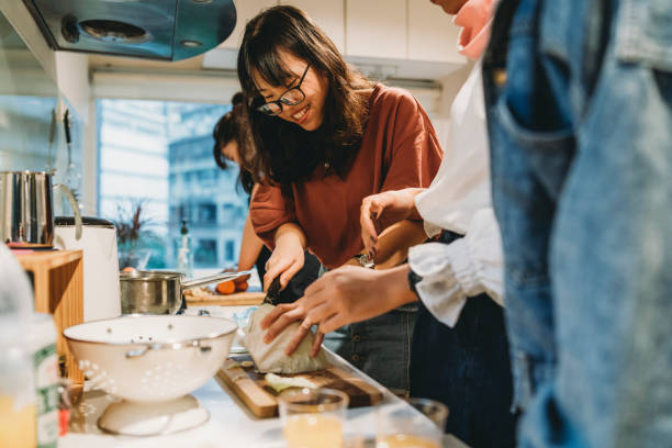 Group of friends preparing dinner together in the kitchen picture id1150936819?b=1&k=6&m=1150936819&s=612x612&w=0&h=b3twzrpq2 iw2fl9hmpbuoqzjvvtf6xncjfuul3a6oc=