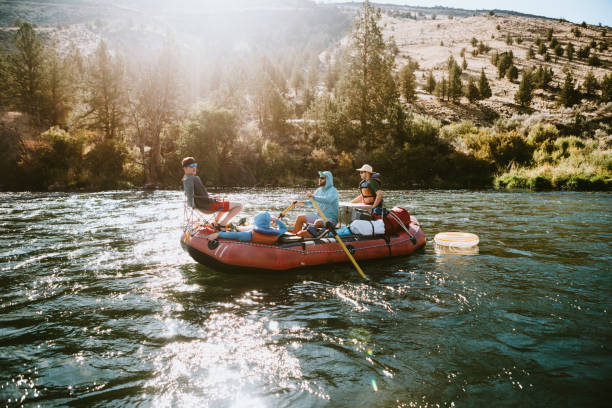 Group of Friends Raft Down Deschutes River in Eastern Oregon stock photo