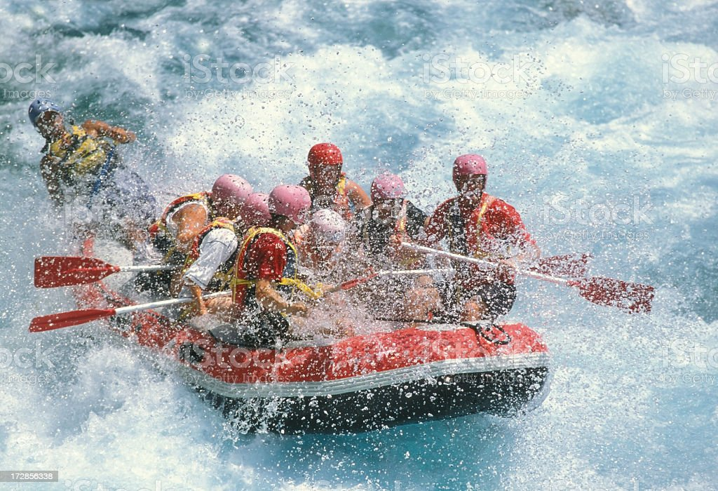 Group of friends rafting on white water stock photo
