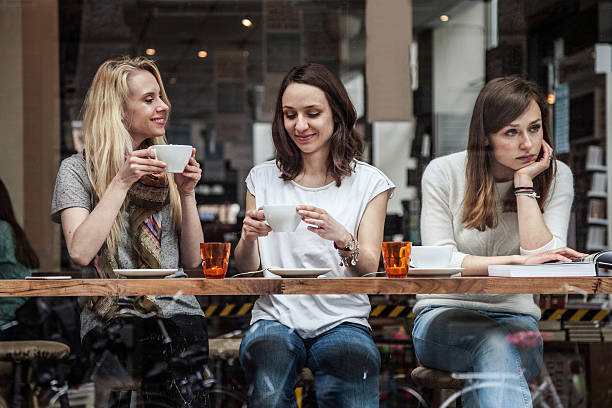 group of friends relaxing at cafe in scandinavia - disbarment stock pictures, royalty-free photos & images