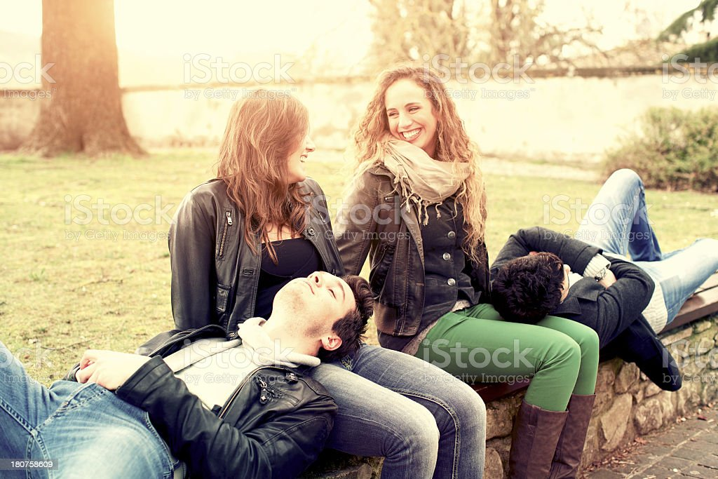 Group of friends relaxing at park royalty-free stock photo