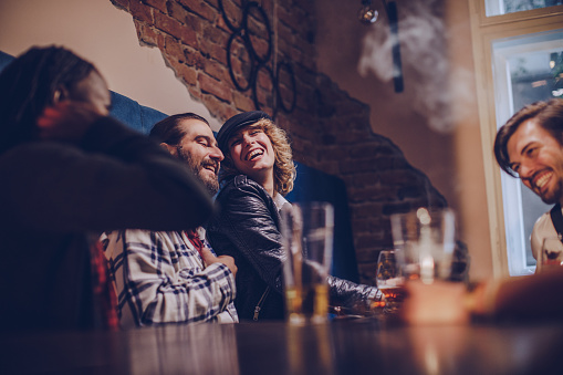 Group Of Friends Relaxing In Bar Stock Photo - Download Image Now