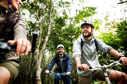 istock Group of friends ride mountain bike in the forest together 951396750