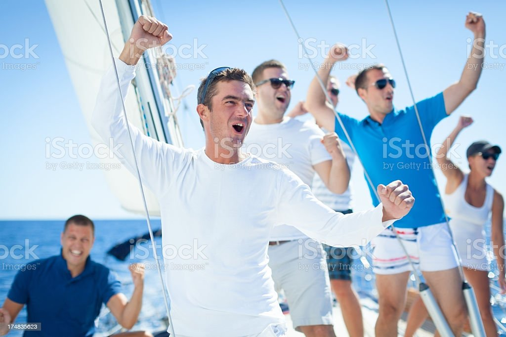 Group of friends ride on the Sailboat royalty-free stock photo