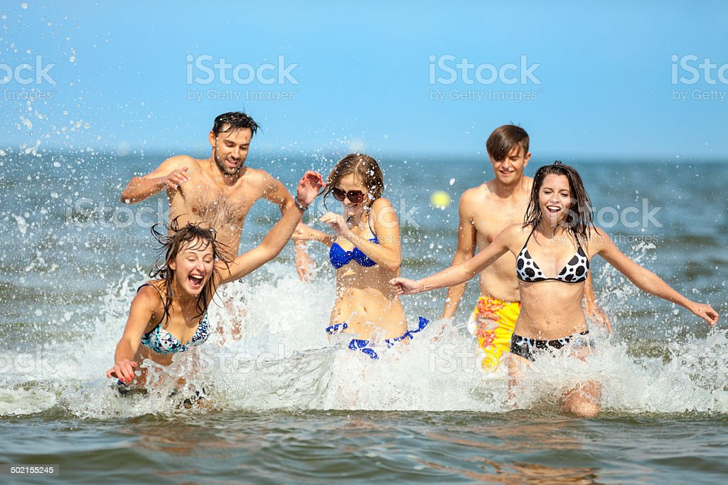 Group Of Friends Running In Sea royalty-free stock photo