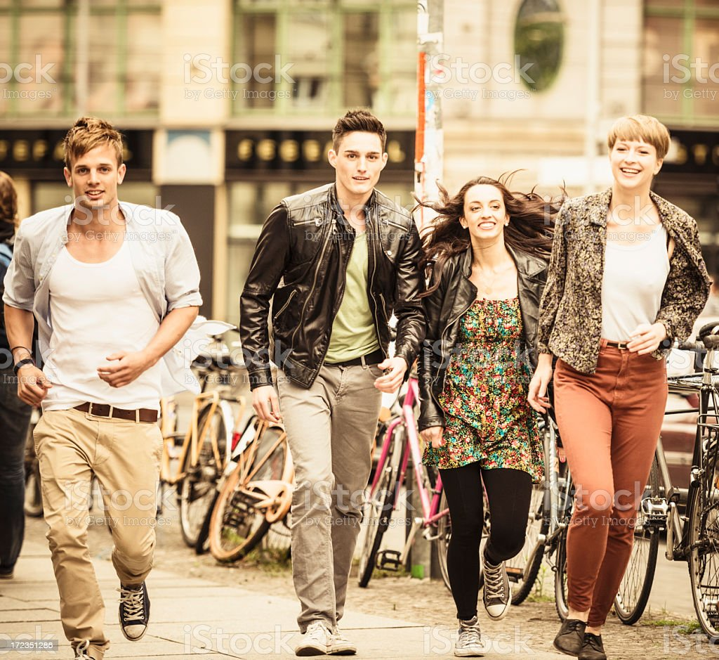 group of friends running on the city royalty-free stock photo