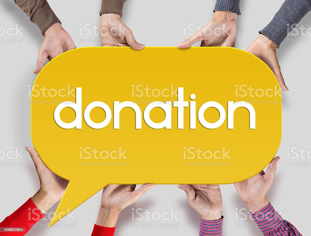 Group of friends showing donation on speech bubble stock photo