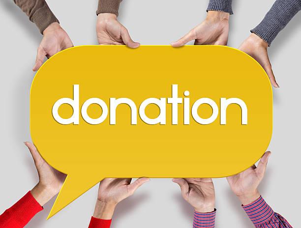 group of friends showing donation on speech bubble - spenden sammeln stock-fotos und bilder