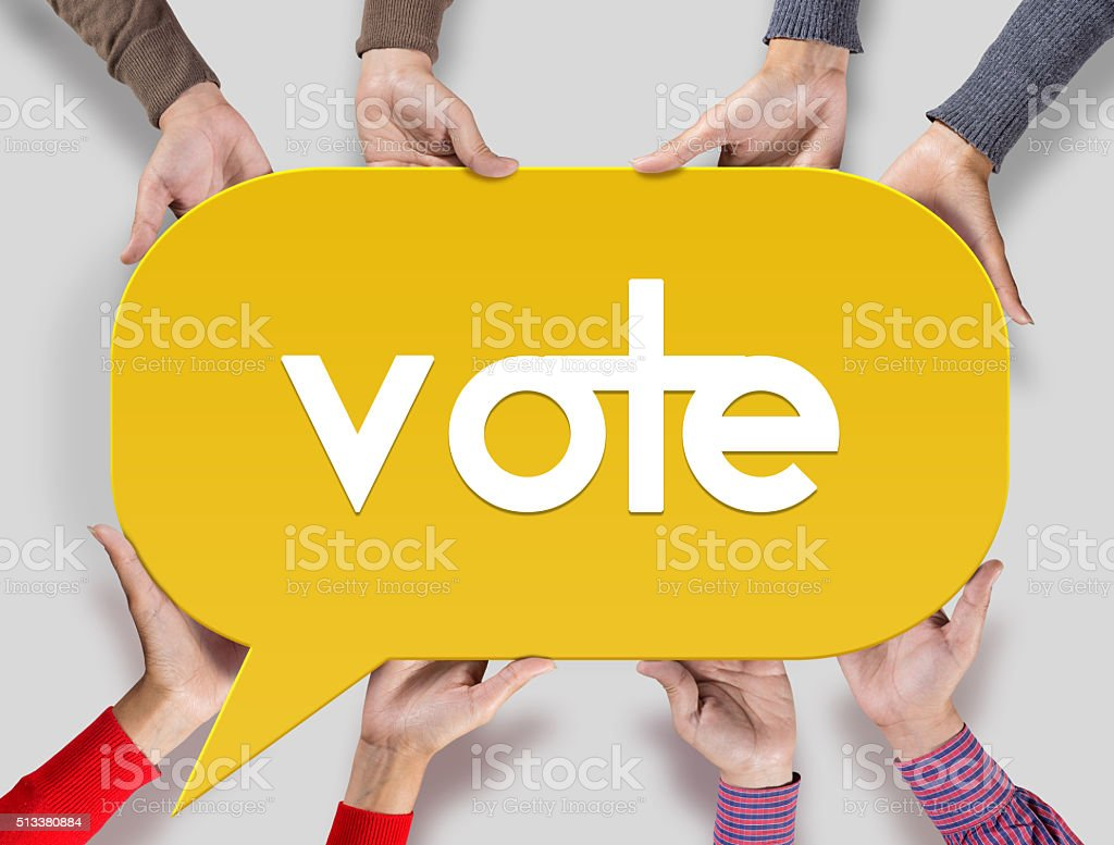 Group of friends showing Vote on speech bubble stock photo