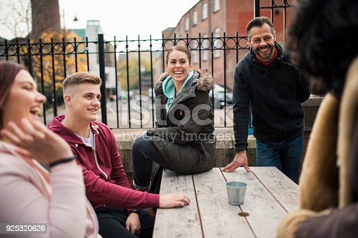 istock A Group Of Friends Sitting At A Picnic Table 925320626