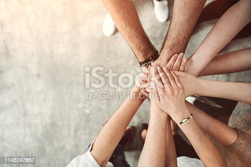 640295168 istock photo Group of friends stack their hands together, teamwork concept 1145247857