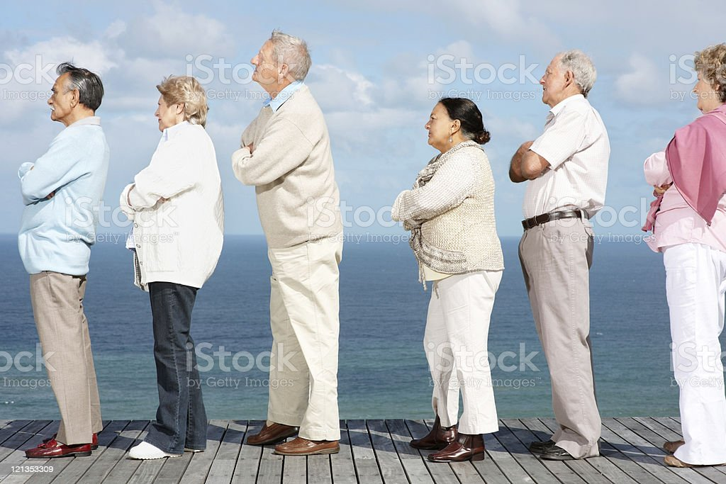 Group of friends standing in a queue with arms crossed royalty-free stock photo
