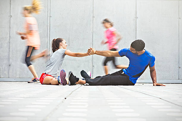 group of friends stretching before run stock photo