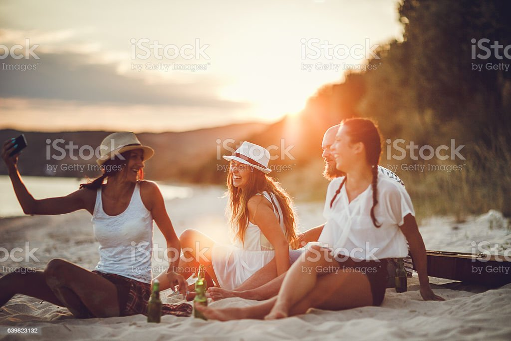 Group of friends taking a selfie outdoors stock photo